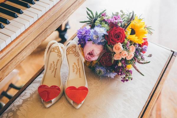 Vivienne Westwood bridal shoes next to bouquet