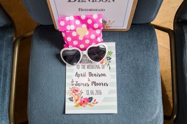 Heart sunglasses on wedding seat
