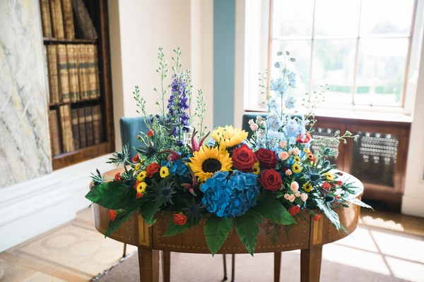 Colourful wedding ceremony flowers