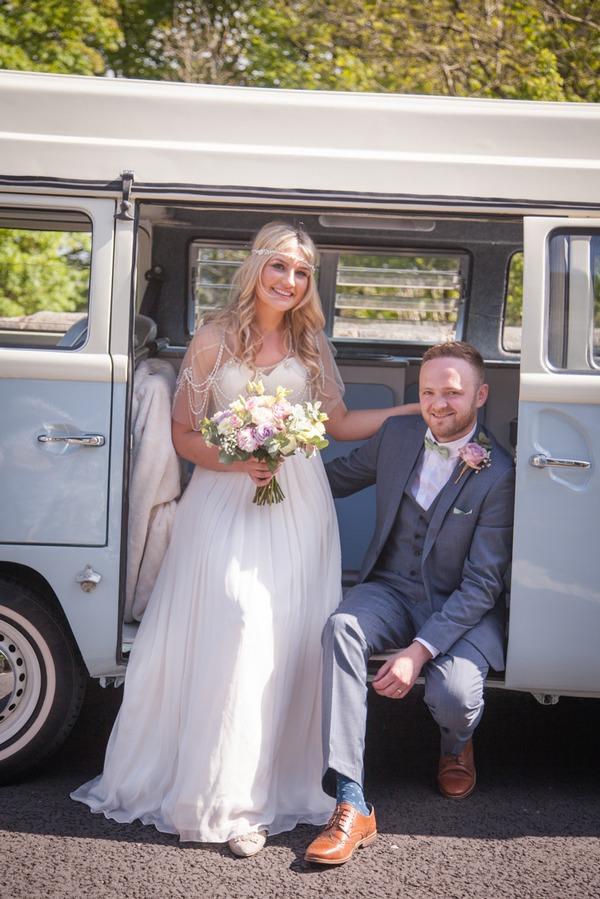 Bride and groom in camper van