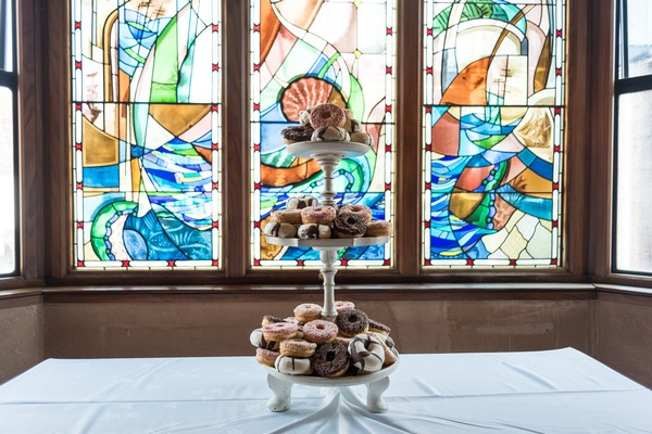 Cake stand of doughnuts at wedding