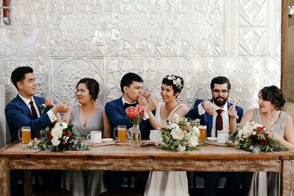 Bridal party sitting together having snacks