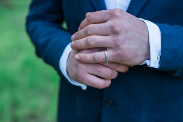 Groom's hands with ring on little finger