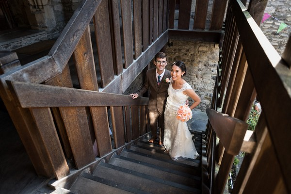 Bride and groom on steps inside Scaplen's Court