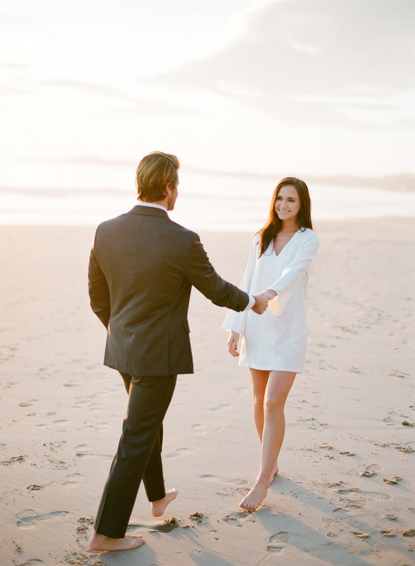 Couple on beach after elopement