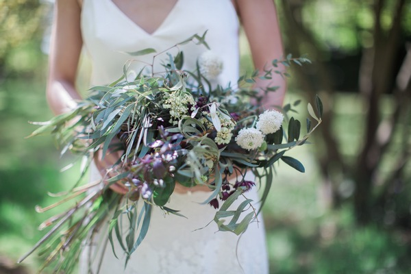 Bride holding wild wedding bouquet