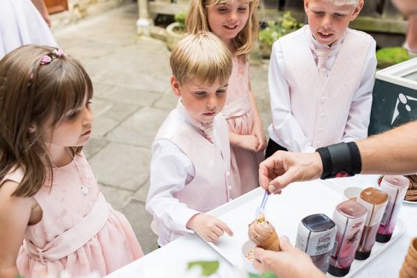 Children being served ice cream