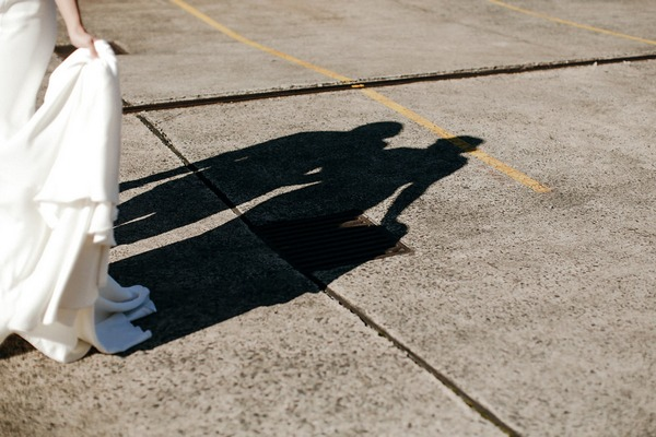 Bride and groom's shadows on ground