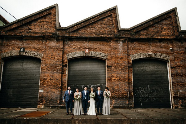Bridal party in front of large door
