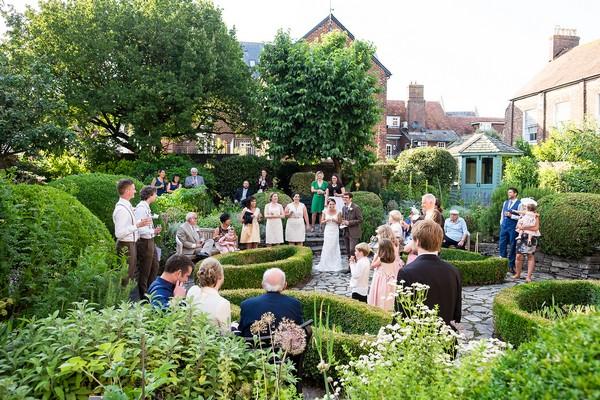 Wedding guests in Scaplen's Court garden