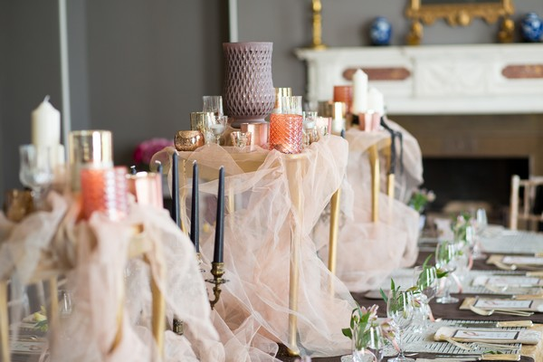 Fabric and candle wedding table centrepiece