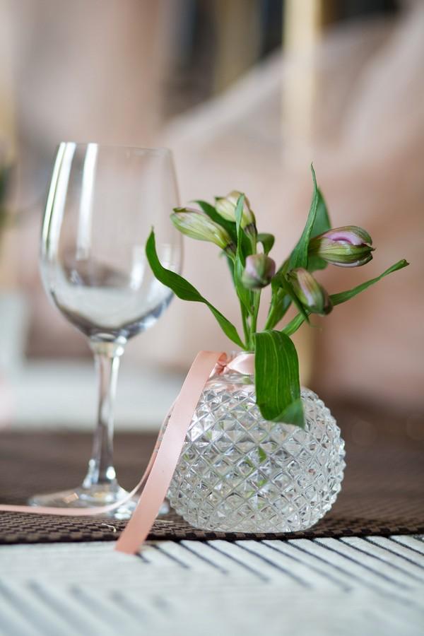 Small perfume bottle vase of flowers