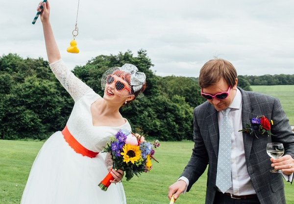 Bride and groom playing Hook-A-Duck