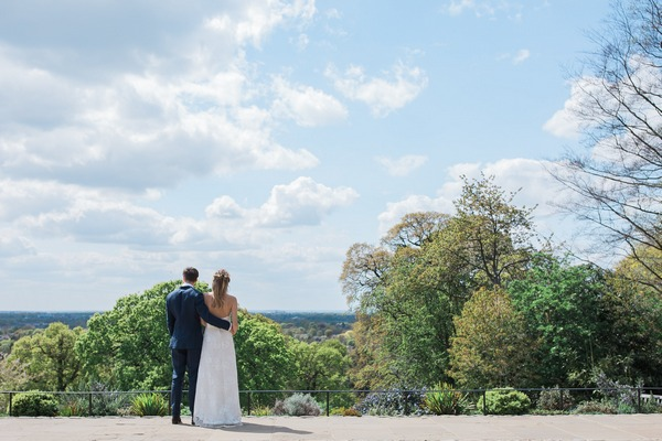 Bride and groom looking at view from Pembroke Lodge