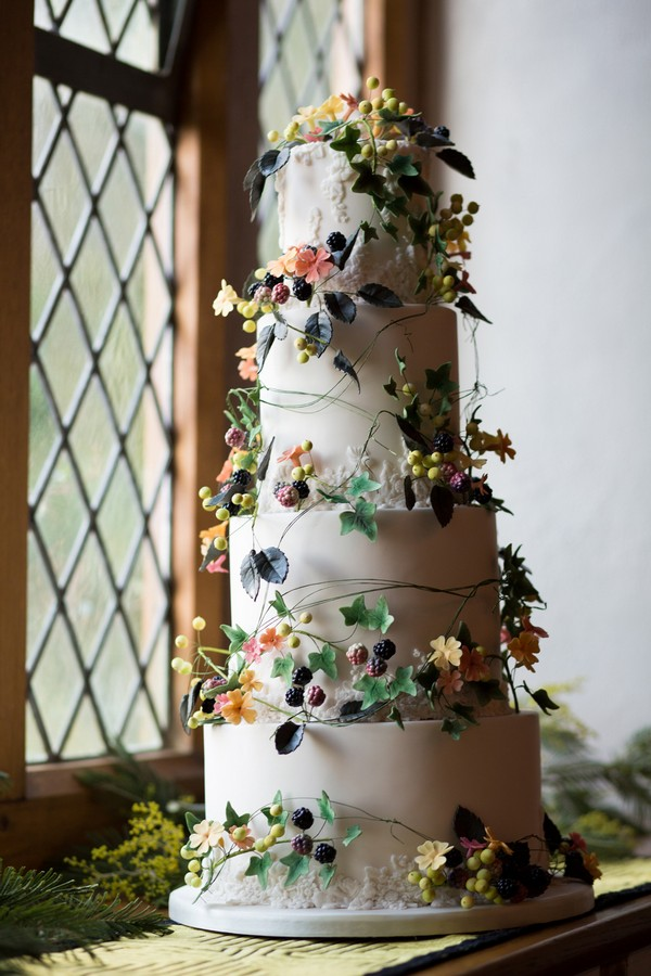 Tall wedding cake with climbing sugar flower detail