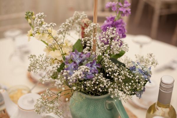 Flowers in jug on wedding table
