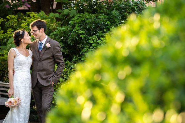 Bride and groom in garden at Scaplen's Court