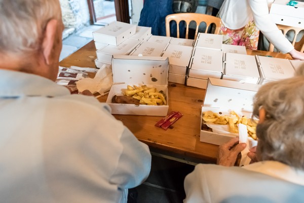 Wedding guests eating fish and chips