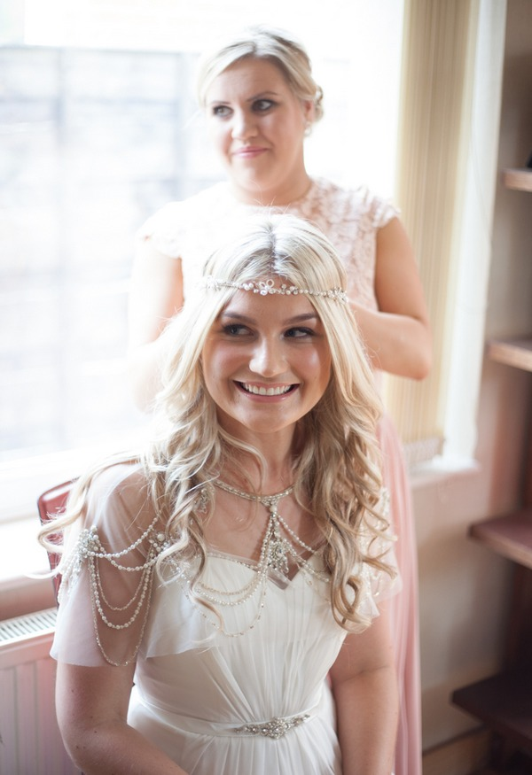 Smiling bride with forehead chain