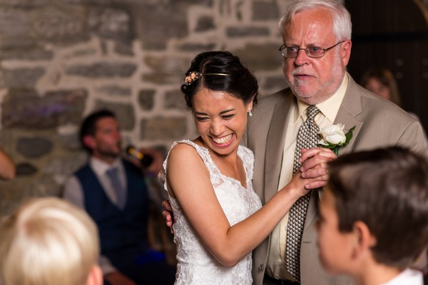 Bride smiling with father