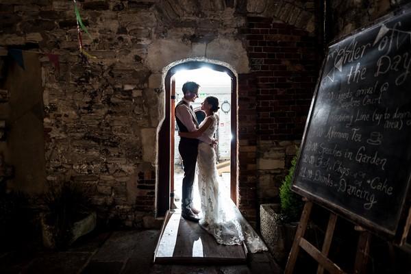 Bride and groom standing in doorway of Scaplen's Court