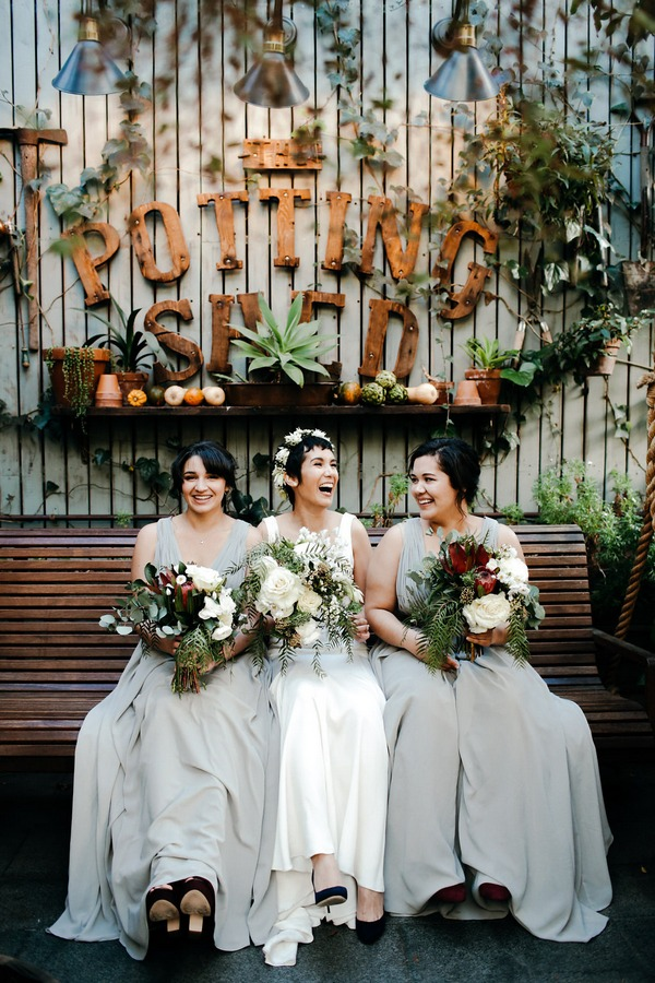 Bride and bridesmaids sitting