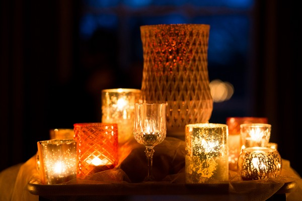 Glass candle holders with lit candles