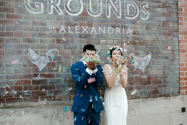 Bride and groom blowing confetti from hands