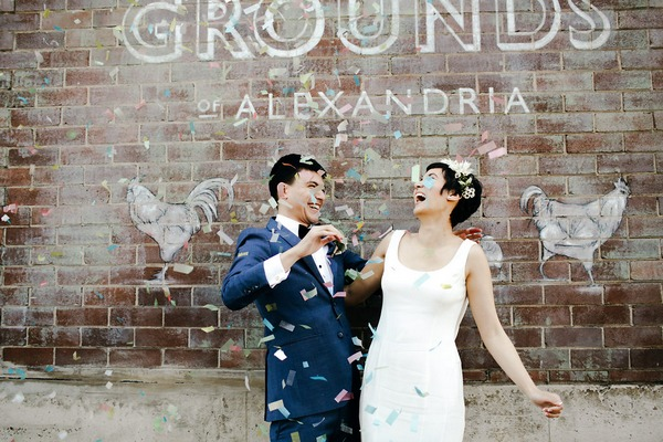 Bride and groom laughing after blowing confetti