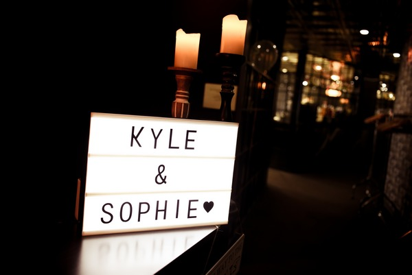 Illuminated sign with bride and groom's names