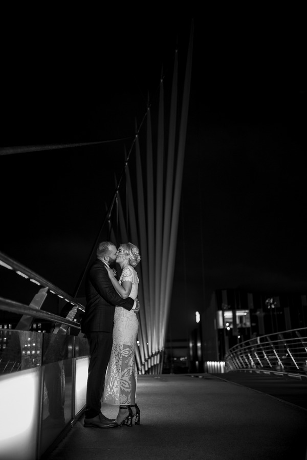 Bride and groom on Manchester Media City Bridge at night