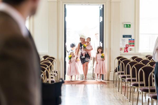 Flower girls entering wedding ceremony