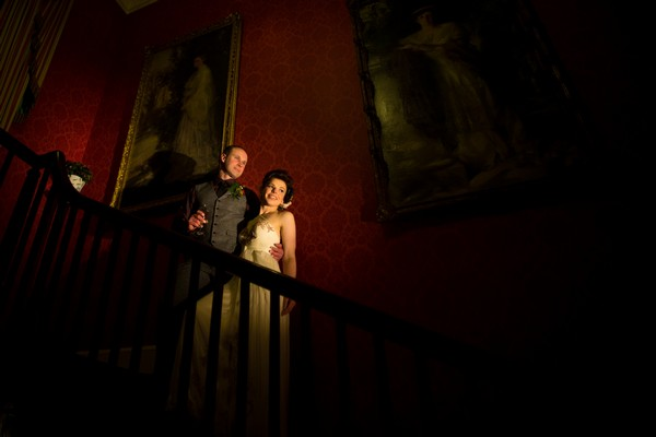 Bride and groom on stairs of Bridwell wedding venue