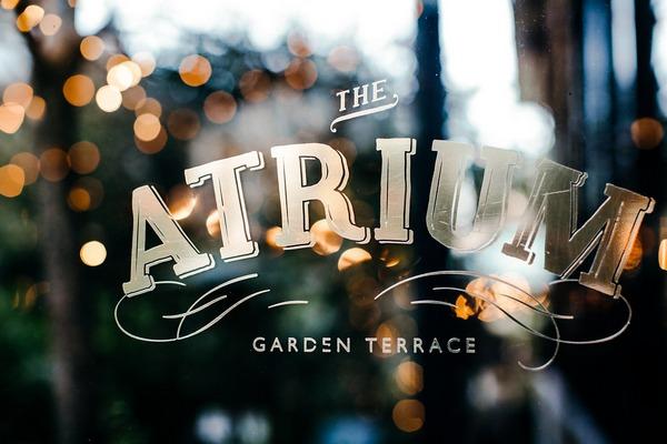 The Atrium Garden Terrace sign in window