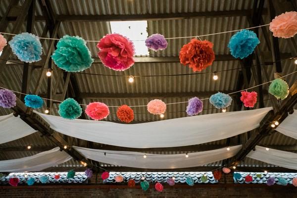 Colourful pom pom ceiling decorations