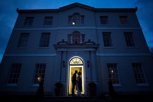 Bride and groom outside Bridwell at night