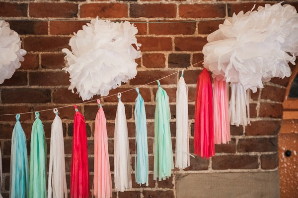 Colourful tassels hanging on wall