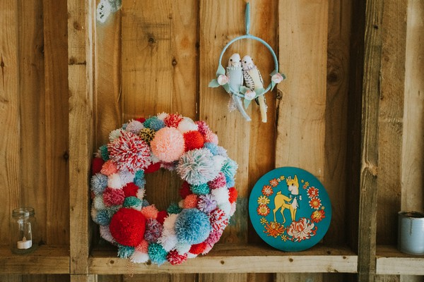 Wreath of colourful pom poms