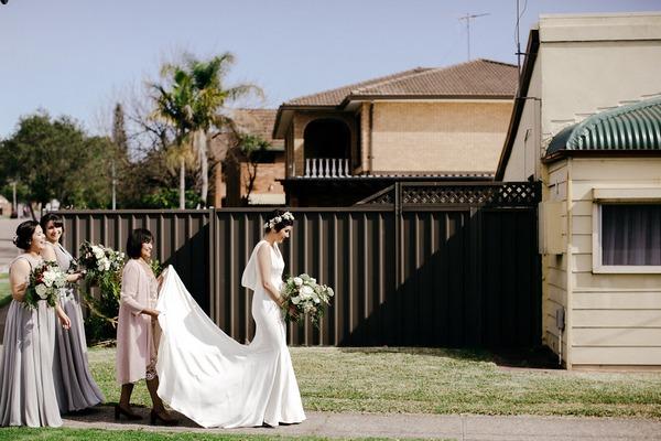 Bride walking down street to wedding