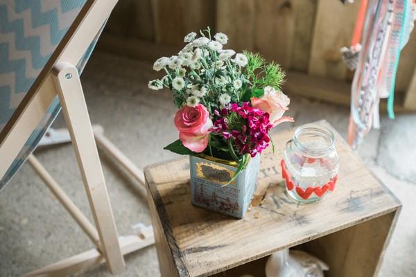 Vintage tin of wedding flowers on table