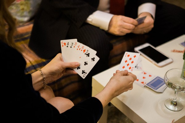 Wedding guests playing cards