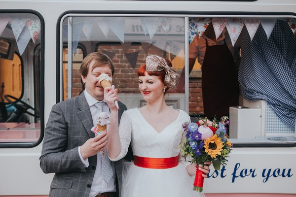 Bride pushing ice cream into groom's face