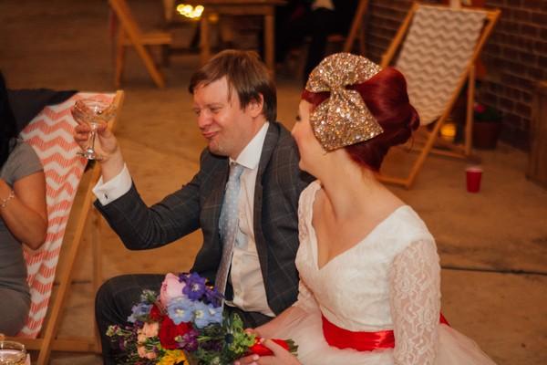 Groom raising glass to toast best man