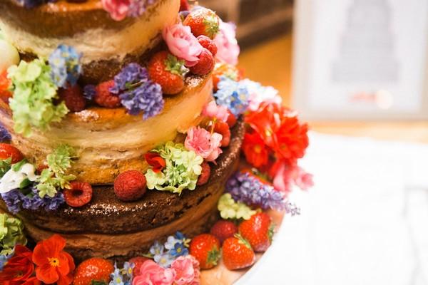 Close-up of fruit on naked wedding cake