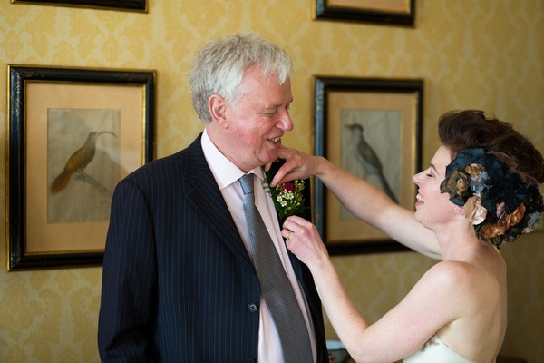Bride helping father with buttonhole