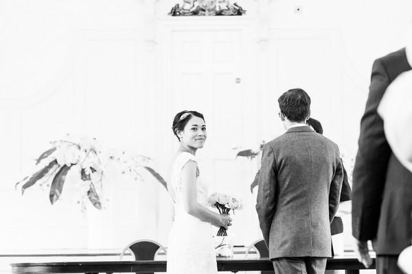 Bride looking over her shoulder during wedding ceremony
