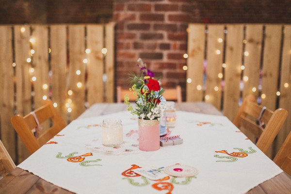 Table with small vase of flowers at wedding
