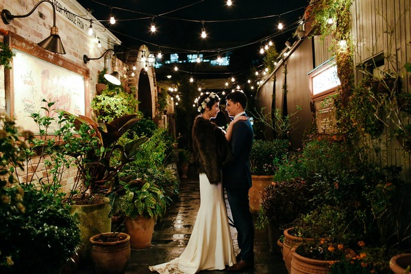 Bride and groom at The Grounds of Alexandria at night