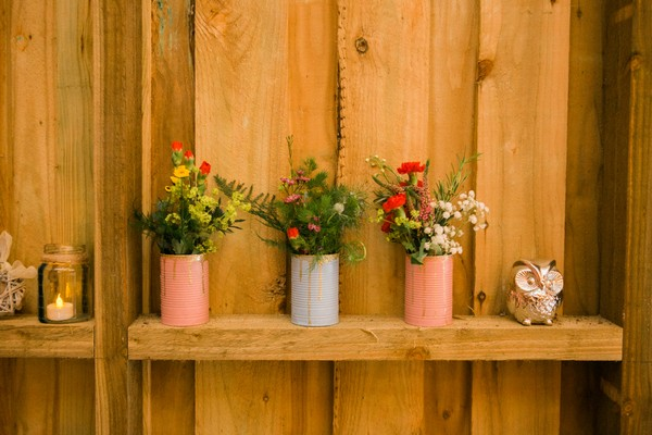 Pots of flowers on shelf at wedding