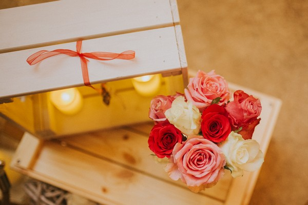 Flowers on crate at wedding
